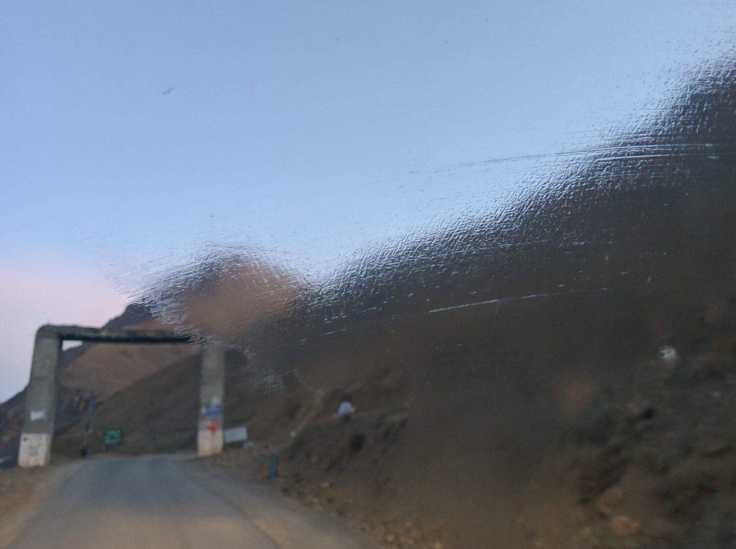 Ice sheet forms on windshield after a cold night in Kaza