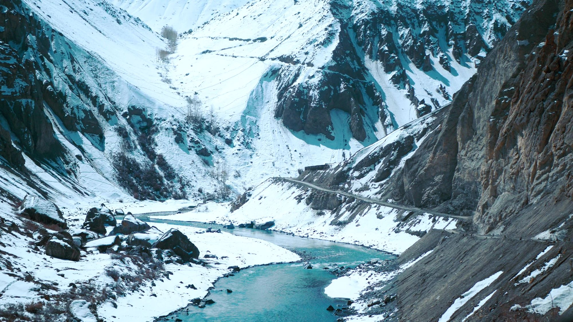 Spiti river flowing through snow covered valley